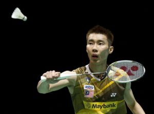 Lee Chong Wei of Malaysia returns the shuttlecock to Wang Zhengming of China during a men's singles first round match of the All England Open Badminton Championships at The National Indoor Arena in Birmingham, central England, on March 7, 2012. AFP PHOTO / MIGUEL MEDINA (Photo credit should read MIGUEL MEDINA/AFP/Getty Images)