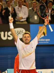 Switzerland's Stanislas Wawrinka celebrates after victory in his men's singles match against Serbia's Novak Djokovic on day nine at the 2014 Australian Open tennis tournament in Melbourne on January 21, 2014. IMAGE RESTRICTED TO EDITORIAL USE - STRICTLY NO COMMERCIAL USE AFP PHOTO / PAUL CROCK